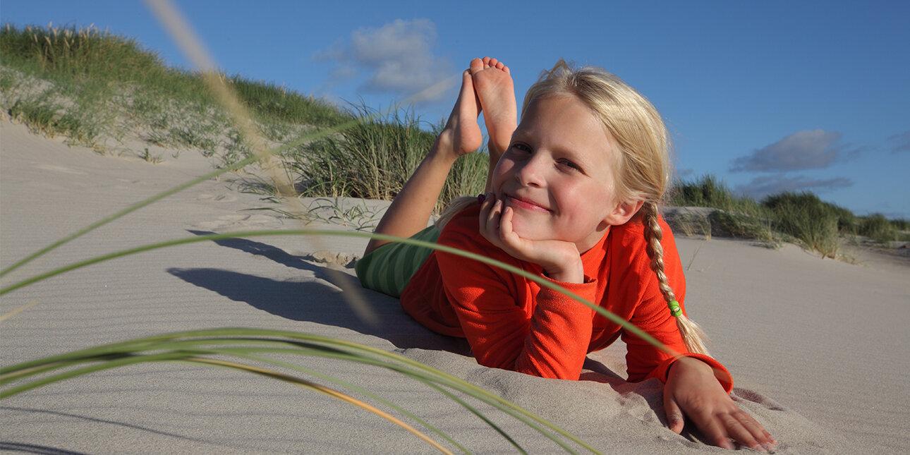 Mädchen am Strand der Nordsee