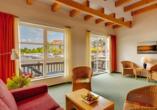 Precise Resort Marina Wolfsbruch, Beispiel Wohnzimmer im Apartment vom Ferienhaus