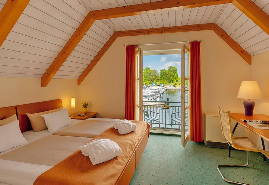Precise Resort Marina Wolfsbruch, Beispiel Schlafzimmer im Apartment vom Ferienhaus