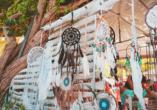 Der Besuch eines Hippiemarkts ist für Sie bereits inkludiert.