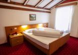Hotel Stella Alpina in Bellamonte, Italien, Zimmerbeispiel