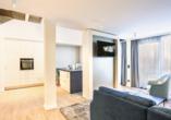Beispiel für einen Wohnbereich in der Kompass Maisonette Suite Landseite.