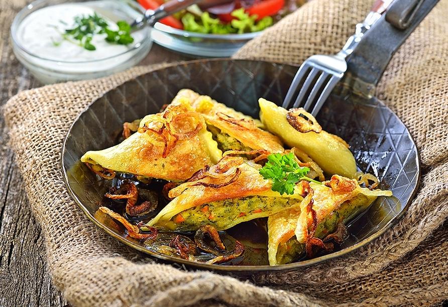 Typisch schwäbische Gerichte, wie die berühmten Maultaschen, sollten Sie sich nicht entgehen lassen!