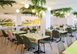 Im Restaurant des Hotels werden Sie mit mediterranen Köstlichkeiten verwöhnt.