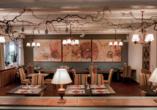 Im stilvoll eingerichteten Restaurant dürfen Sie sich kulinarisch verwöhnen lassen.