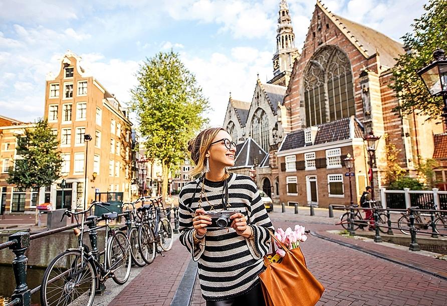 Unternehmen Sie eine Sightseeingtour in Amsterdam.