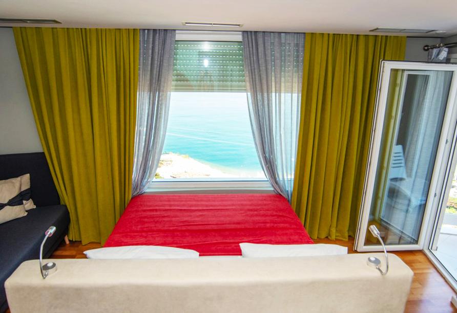 Beispiel eines Doppelzimmers mit Meerblick im Hotel Bougainville Bay Resort & Spa