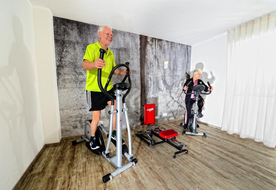 Powern Sie sich im hoteleigenen Fitnessraum aus!