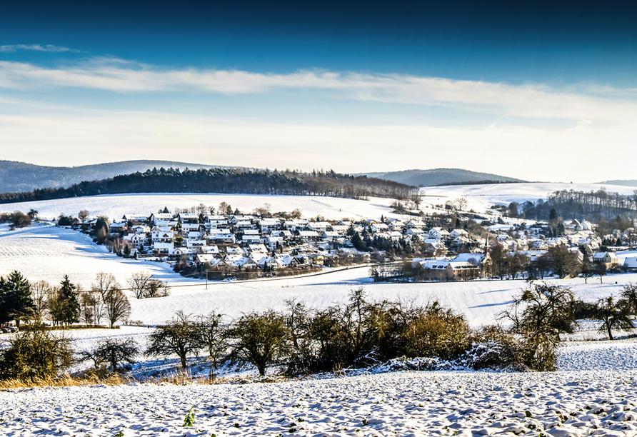 Freuen Sie sich auf verschneite Hügellandschaften im Spessart.